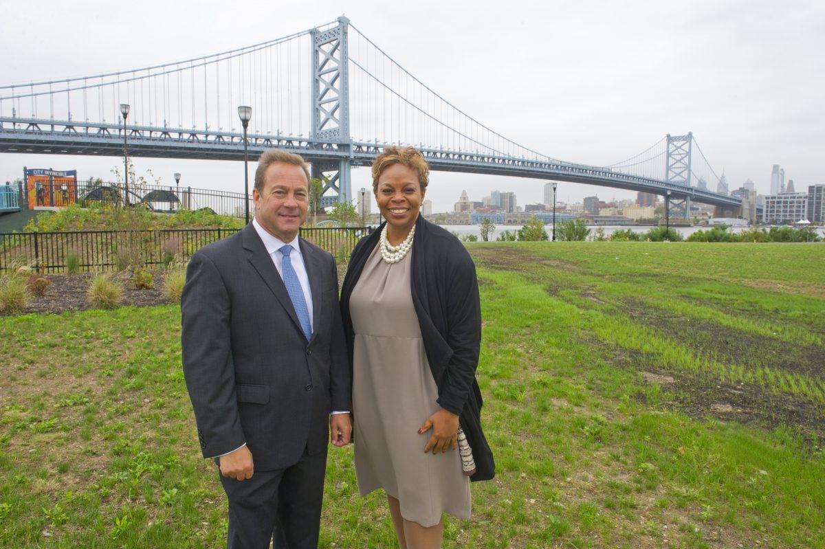 Camden County Freeholder Director Louis Cappelli Jr. and Camden Mayor Dana L. Redd stand on the site of the former Riverfront Prison, just north of the Ben Franklin Bridge in North Camden. This is one of the sites being promoted to attract Amazon's second headquarters project.