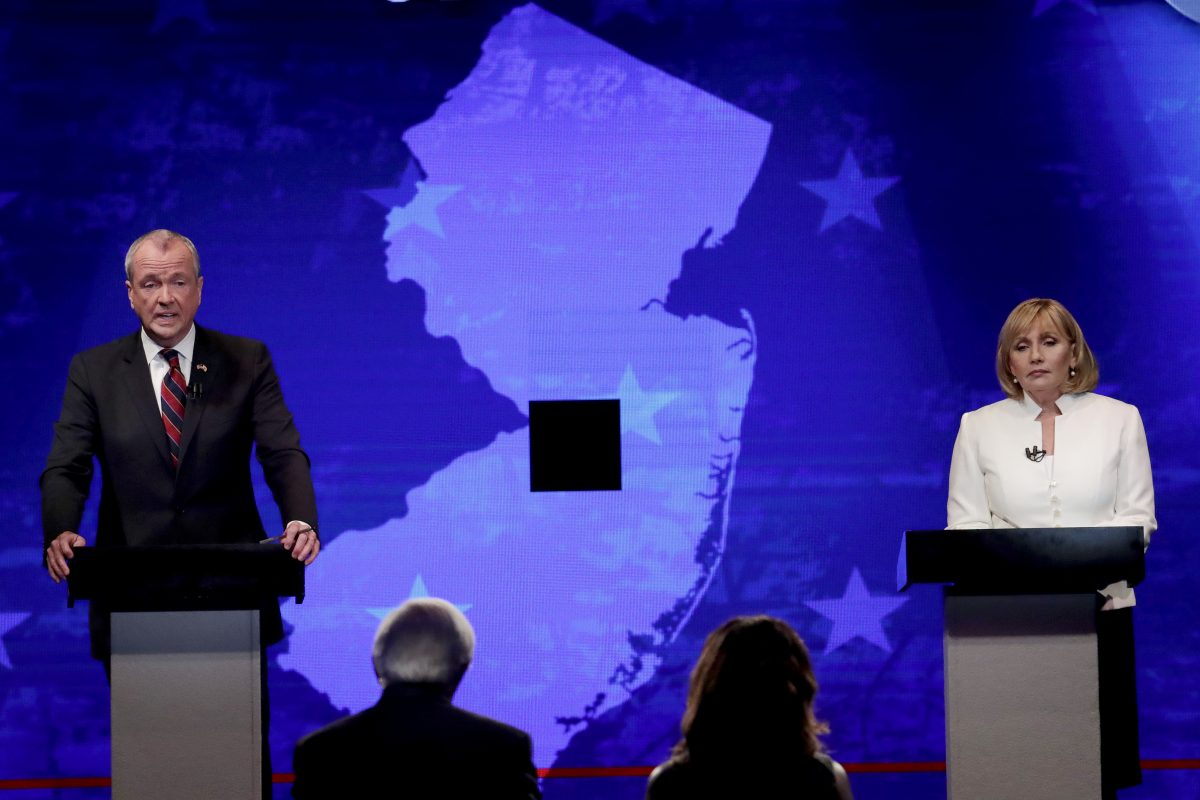 Democratic nominee Phil Murphy, left, and Republican nominee Lt. Gov. Kim Guadagno, right, participates in a gubernatorial debate at the New Jersey Performing Arts Center, Tuesday, Oct. 10, 2017, in Newark, N.J. (AP Photo/Julio Cortez, pool)