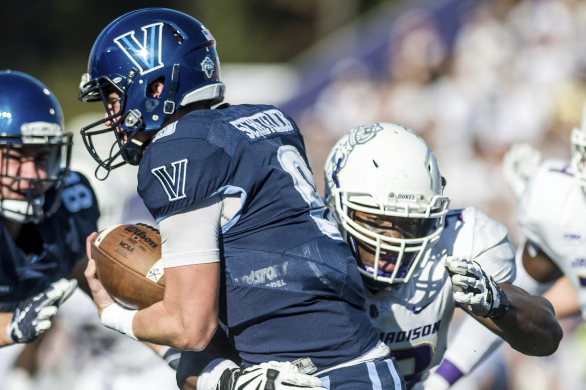 James Madison defensive lineman Andrew Ankrah (93) latches onto Villanova quarterback Jack Schetelich (9) during the first half of an NCAA football game in Harrisonburg, Va., Saturday, October 14, 2017. (Daniel Lin/Daily News-Record via AP)