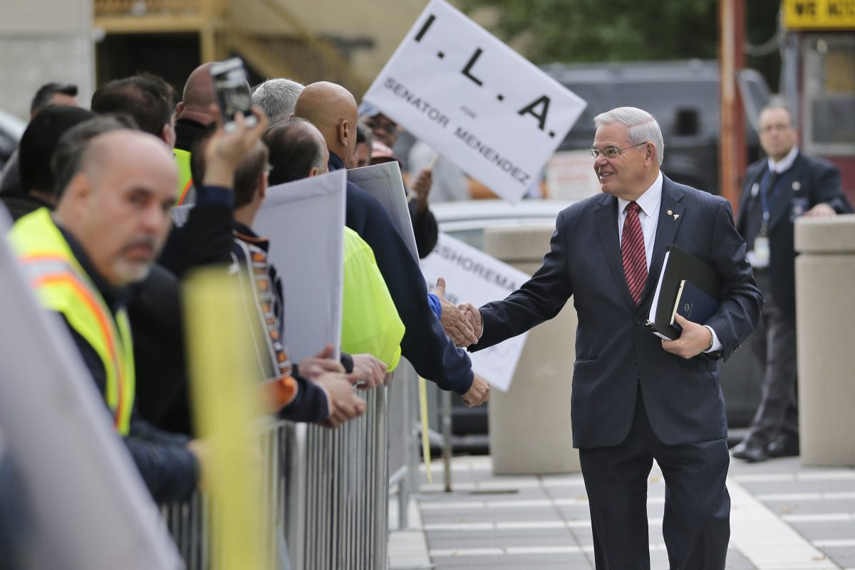U.S. Senator Bob Menendez greets supporters as he arrives to court in Newark, N.J., on Monday.