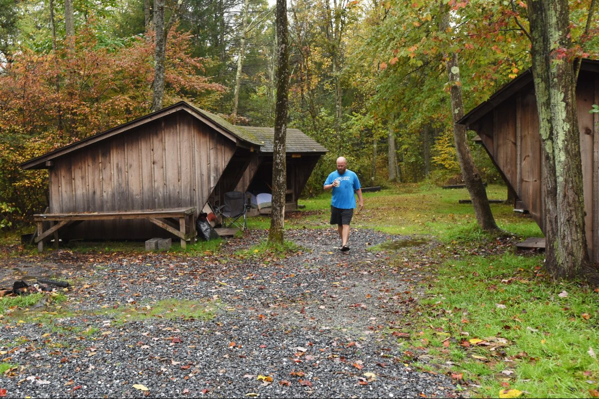 Army Vet Steve Clendenning takes an early moring walk through the New Ringgold Boy Scout Camp during the Veterans River House gathering Sunday Oct.8, 2017 in New Ringgold, Pa.