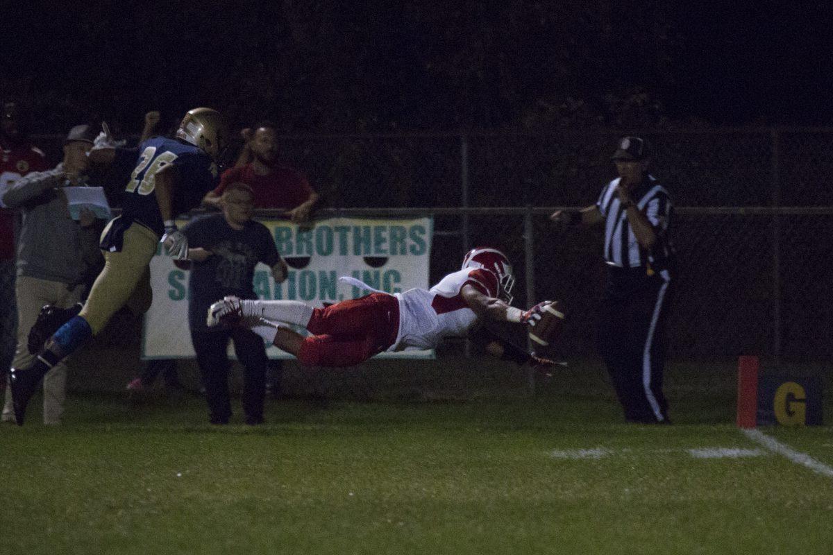 Delsea junior running back Aiden Borguet dives for a touchdown against Holy Spirit.