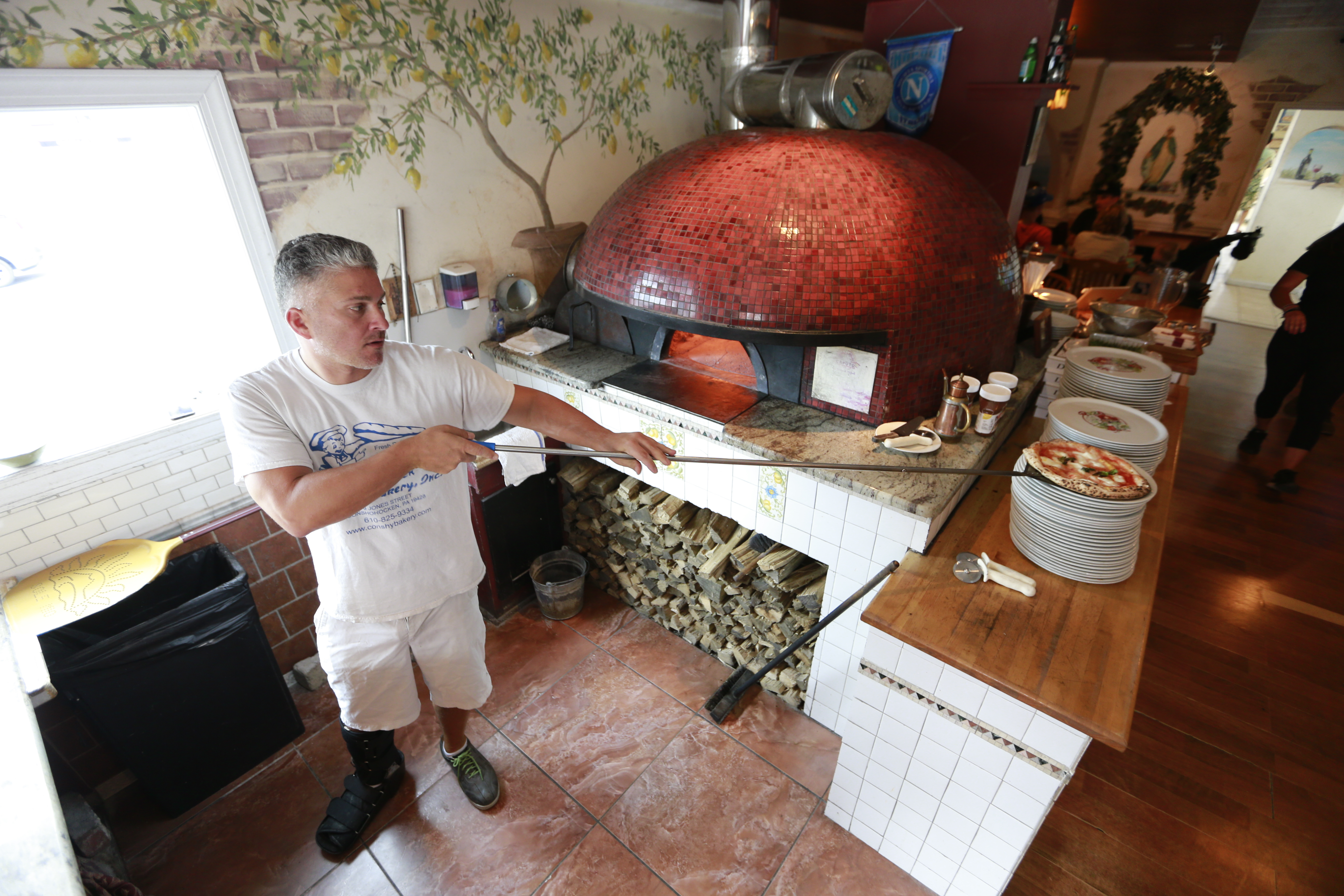 Frank Nattle makes perhaps the single best Regina pizza in the region at Vecchia in Phoenixville.