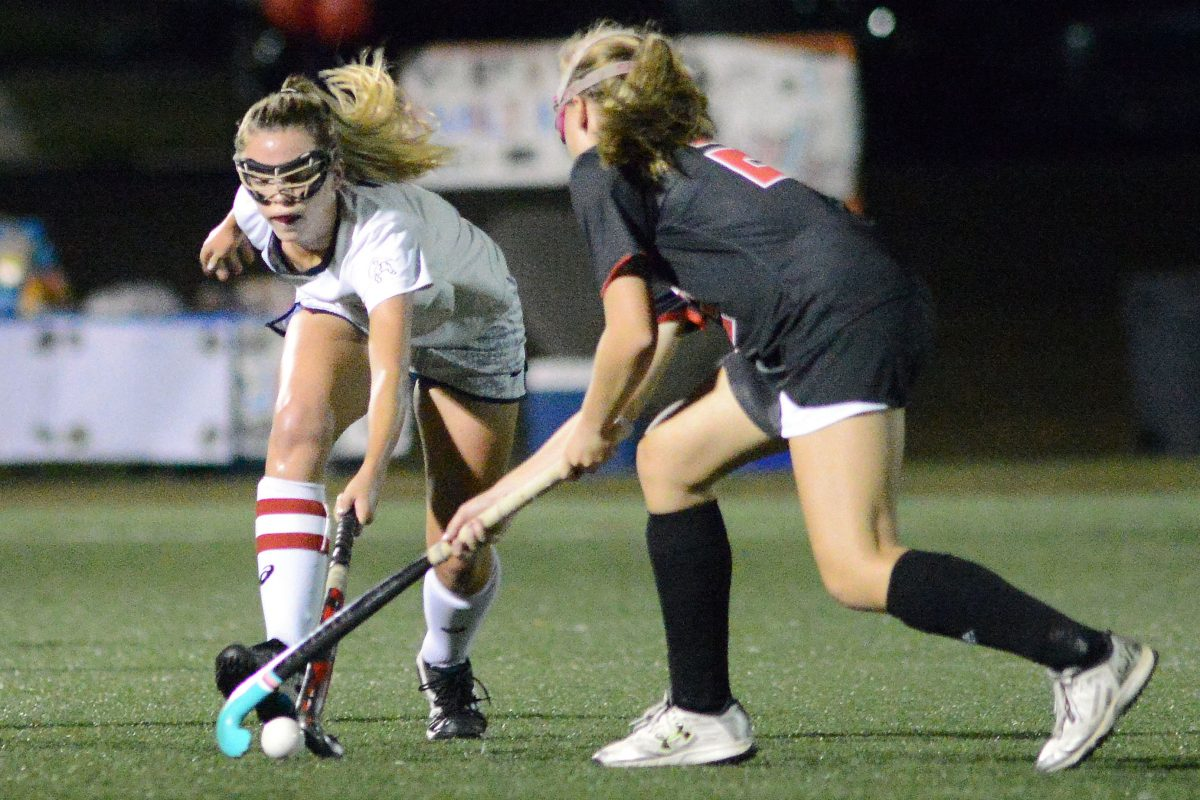Plymouth Whitmarsh´s Sophie Kolkka (3) pokes at the ball as Hatboro-Horsham´s Paige Mullen (20) defends in a game on Oct. 10.