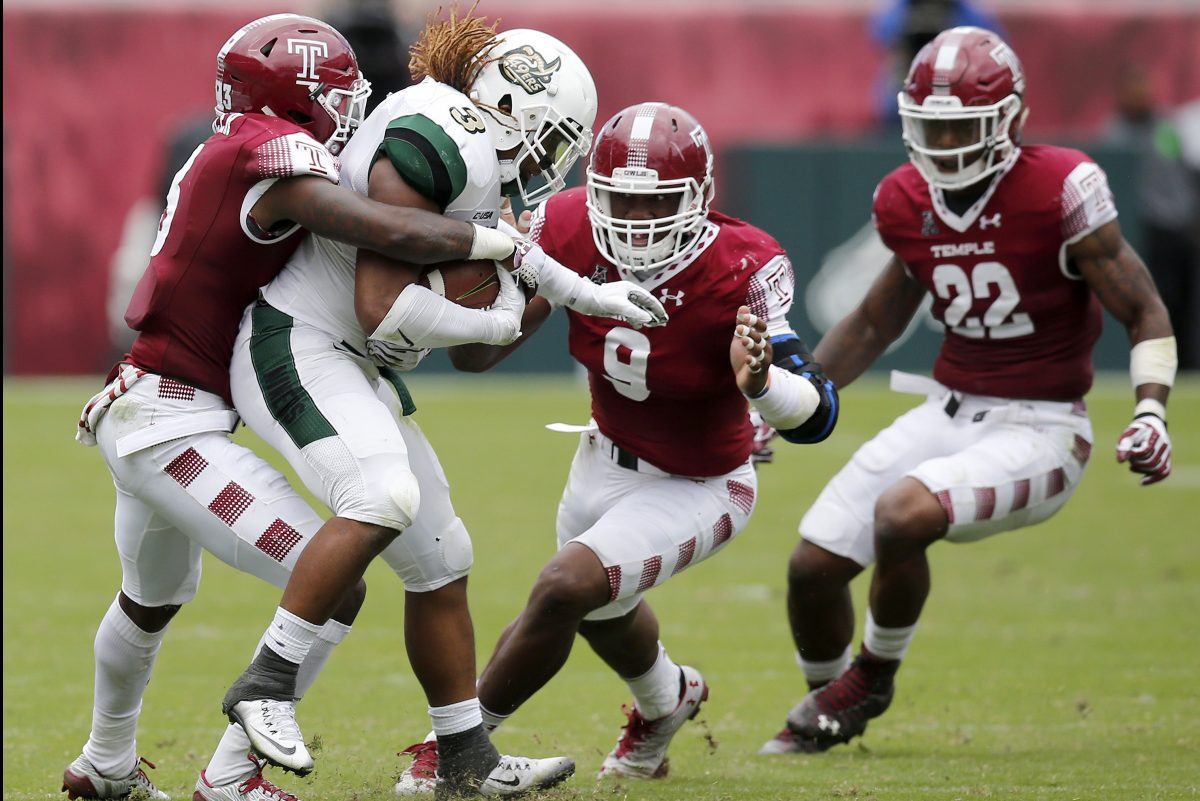 Temple´s (l-r): Sean Chandler, Jacob Martin and Chapelle Russell go after Charlotte´s Kalif Phillips on Saturday, September 24, 2016 in Philadelphia. YONG KIM / Staff Photographer