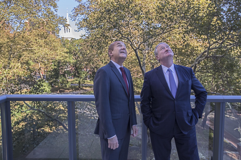 Developer Tom Scannapieco, left, and Philadelphia Mayor Kenney look up a the glass facade of Scannapieco's 500 Walnut condominiums.