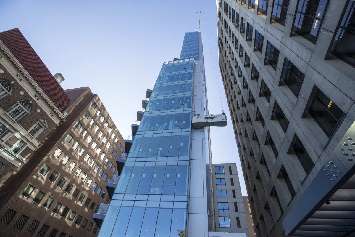 The 500 Walnut condominiums, all glass and steel, rise over Walnut Street and Fifth Street on Tuesday — the day of its grand opening.
