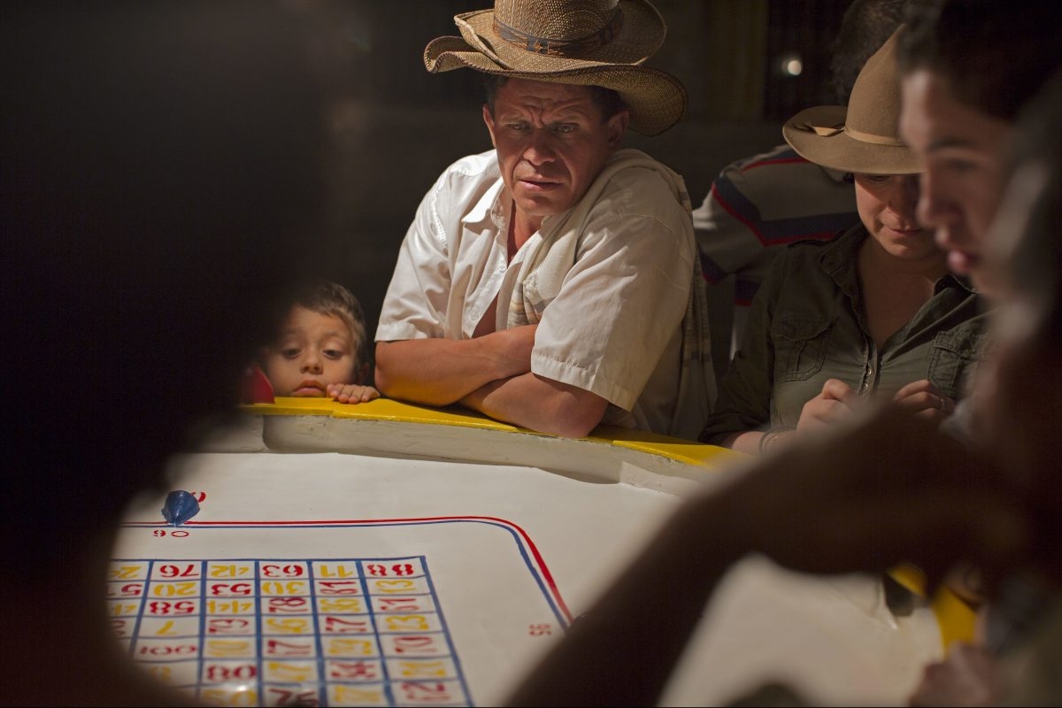 "Tony Rocco's photograph, ""Small Town Gambler (La Florida, Colombia),"" 2012, archival pigment print, from ""The Expanded Caribbean"" at Drexel University's Leonard Pearlstein Gallery."