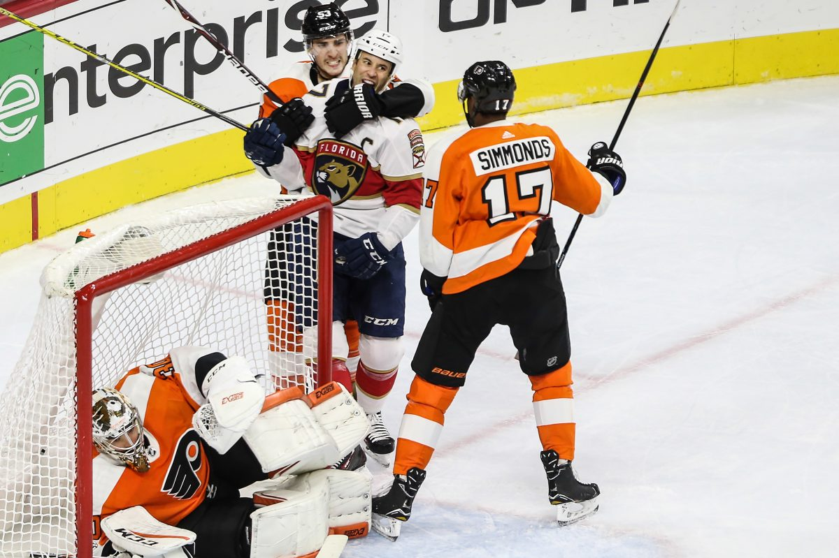 Shayne Gostisbehere and Wayne Simmonds have words with the Panthers' Derek MacKenzie for pushing goalie Michal Neuvirth down while Claude Giroux was busy scoring at the other end of the rink Tuesday.