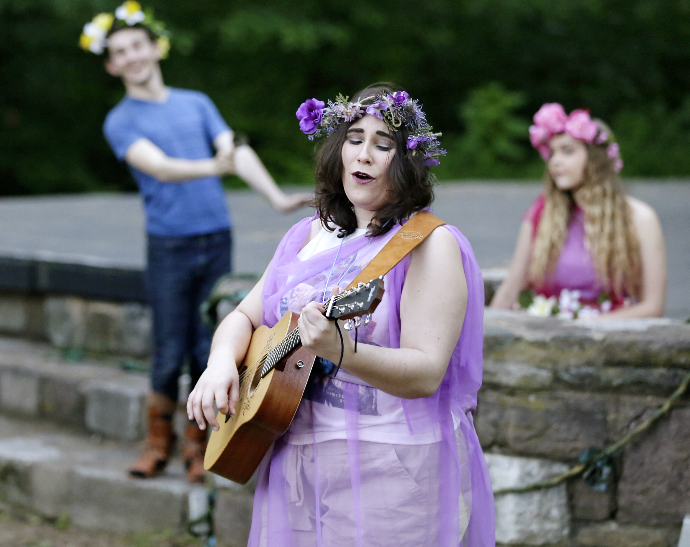 "Kelsey Brown (Hippolyta and Cobweb) plays guitar during reheasal of ""A Midsummer Night´s Dream"" at the Norcross-McLaughlin Dell in Haddon Heights on June 2, 2017. They call themselves the Ignoble Shakespeare Company, and they´re bringing Shakespeare in the Park to SJ with free productions of ´A Midsummer Night´s Dream´ on June 9 and 10."