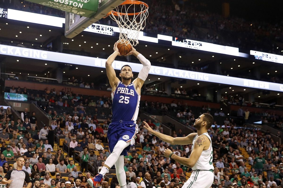 The 76ers´ Ben Simmons goes in for a dunk past the Celtics´ Abdel Nader during a preseason game Oct. 9.