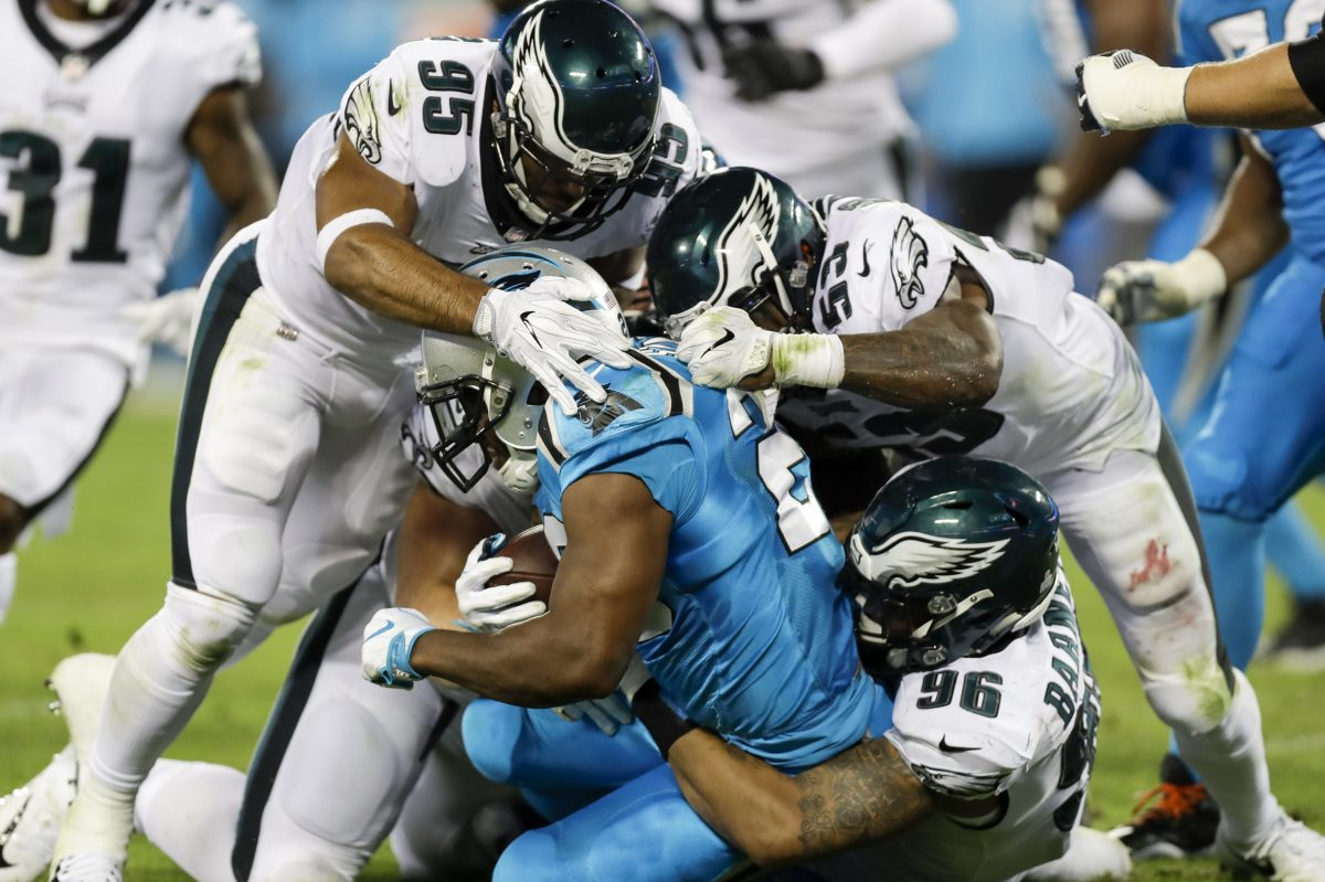 Philadelphia Eagles outside linebackers Mychal Kendricks and Nigel Bradham, and defensive end Derek Barnett, stop Carolina Panthers running back Jonathan Stewart during the third quarter at Bank of America Stadium in Charlotte, N.C., on Thursday, Oct. 12, 2017. The Eagles won, 28-23. (Yong Kim/Philadelphia Daily News/TNS)