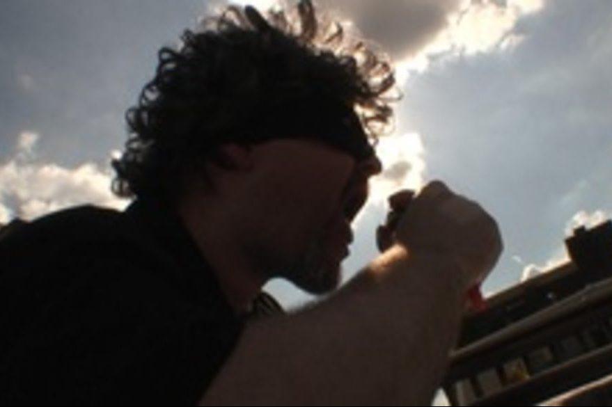 A masked Craig LaBan sings about cheeseburgers.
