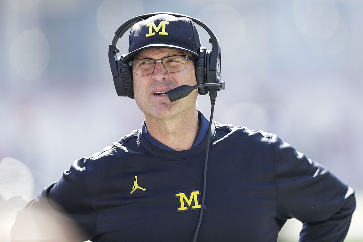 Michigan head coach Jim Harbaugh walks the sidelines while playing Indiana in the second half of an NCAA college football game in Bloomington, Ind., Saturday, Oct. 14, 2017. Michigan won 27-20 in overtime.