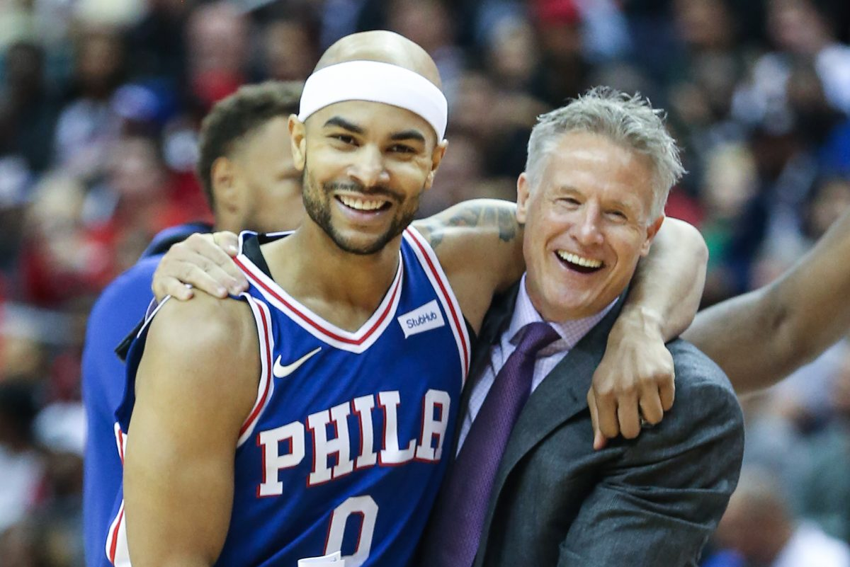 Sixers coach Brett Brown hugs Jerryd Bayless after the guard hit a three-pointer against the Wizards.