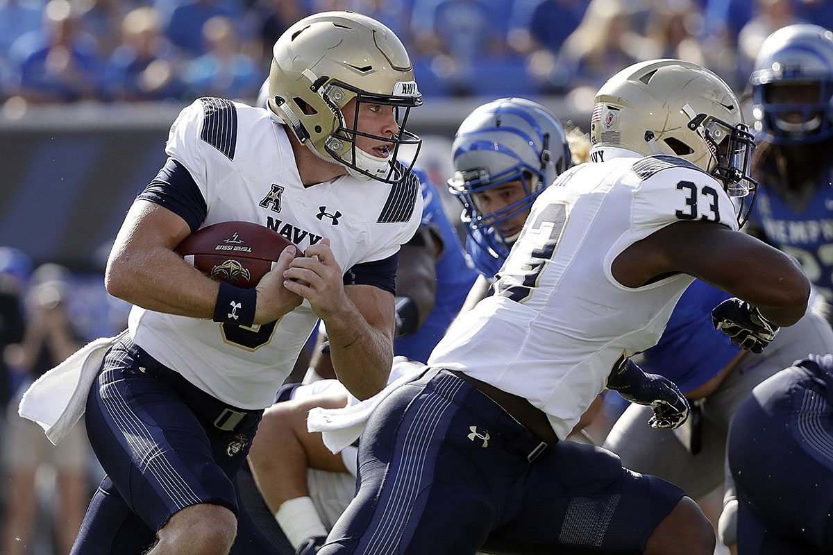 Navy quarterback Zach Abey, left, runs the ball behind the blocking of fullback Chris High (33) in the first half of an NCAA college football game against Memphis Saturday, Oct. 14, 2017, in Memphis, Tenn.