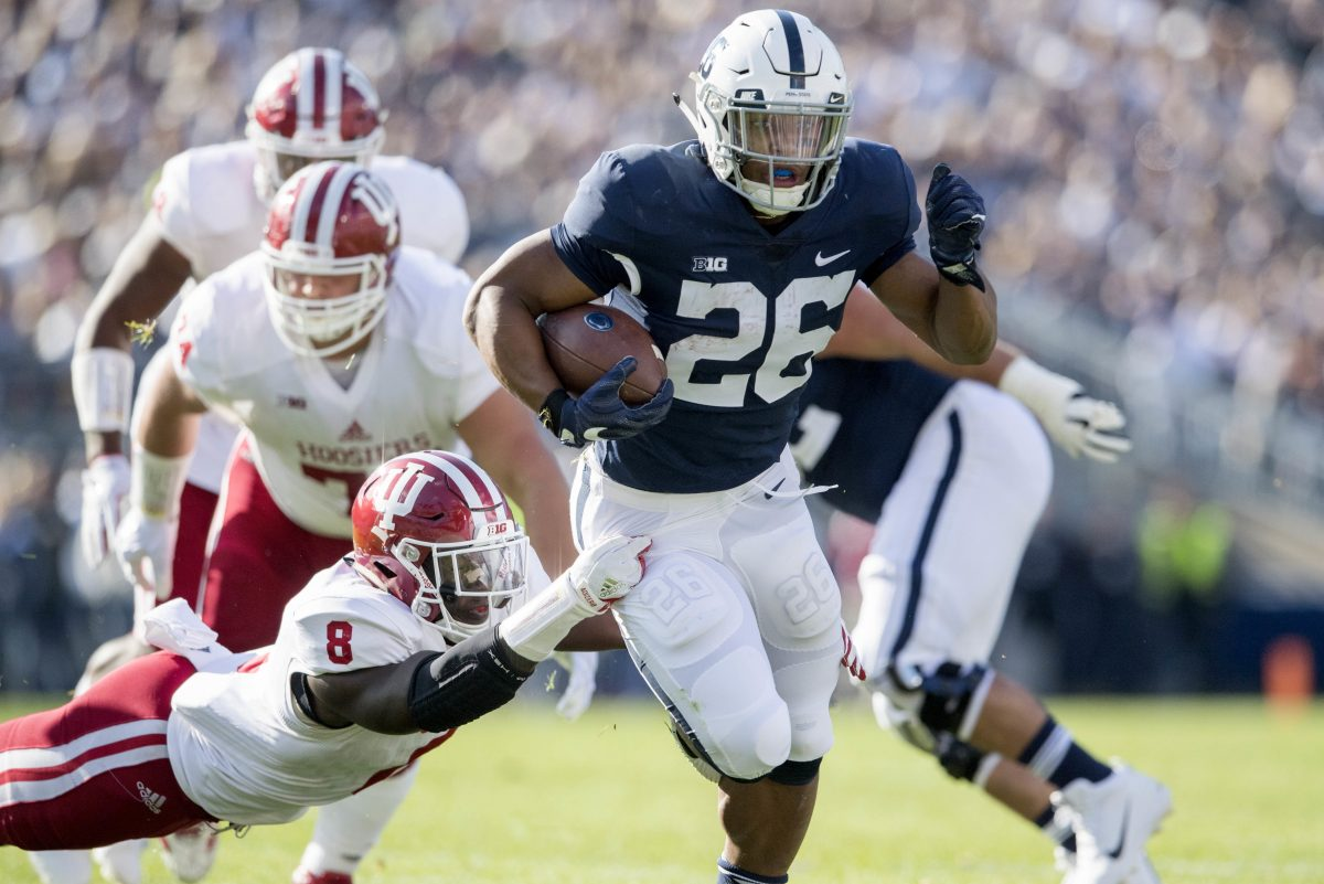 Indiana linebacker Tegray Scales (8) can't stop Penn State running back Saquon Barkley (26) on Sept. 30 at Beaver Stadium.