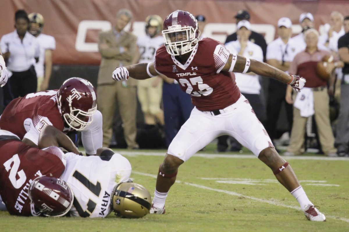 Delvon Randall of Temple celebrates a sack of Army quarterback Ahmad Bradshaw during the teams' matchup last season.