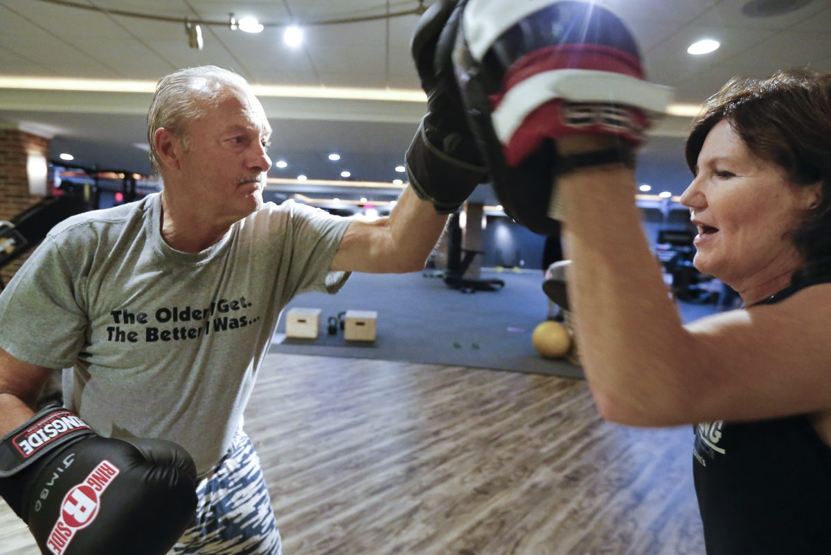 Rock Steady Boxing coach Anne Haneman (right) fends off the punches of James Brown , 70, who has been living with Parkinson's Disease for a year and a half, during a workout at Unbound Synergy in New Hope, PA.  Boxing delays the effects of the  progressive movement disorder.