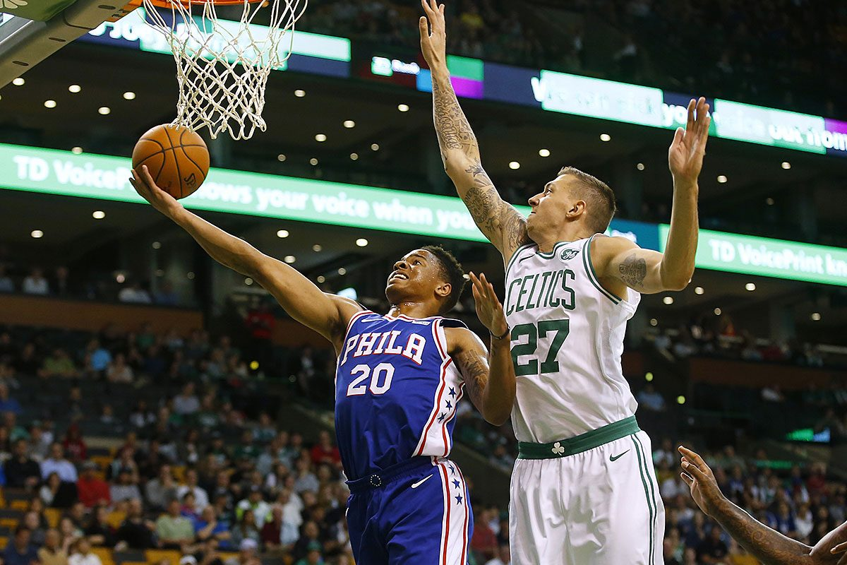 Philadelphia 76ers guard Markelle Fultz goes to the basket past Boston Celtics' Daniel Theis (27) during the first quarter of a preseason NBA basketball game in Boston Monday, Oct. 9, 2017.