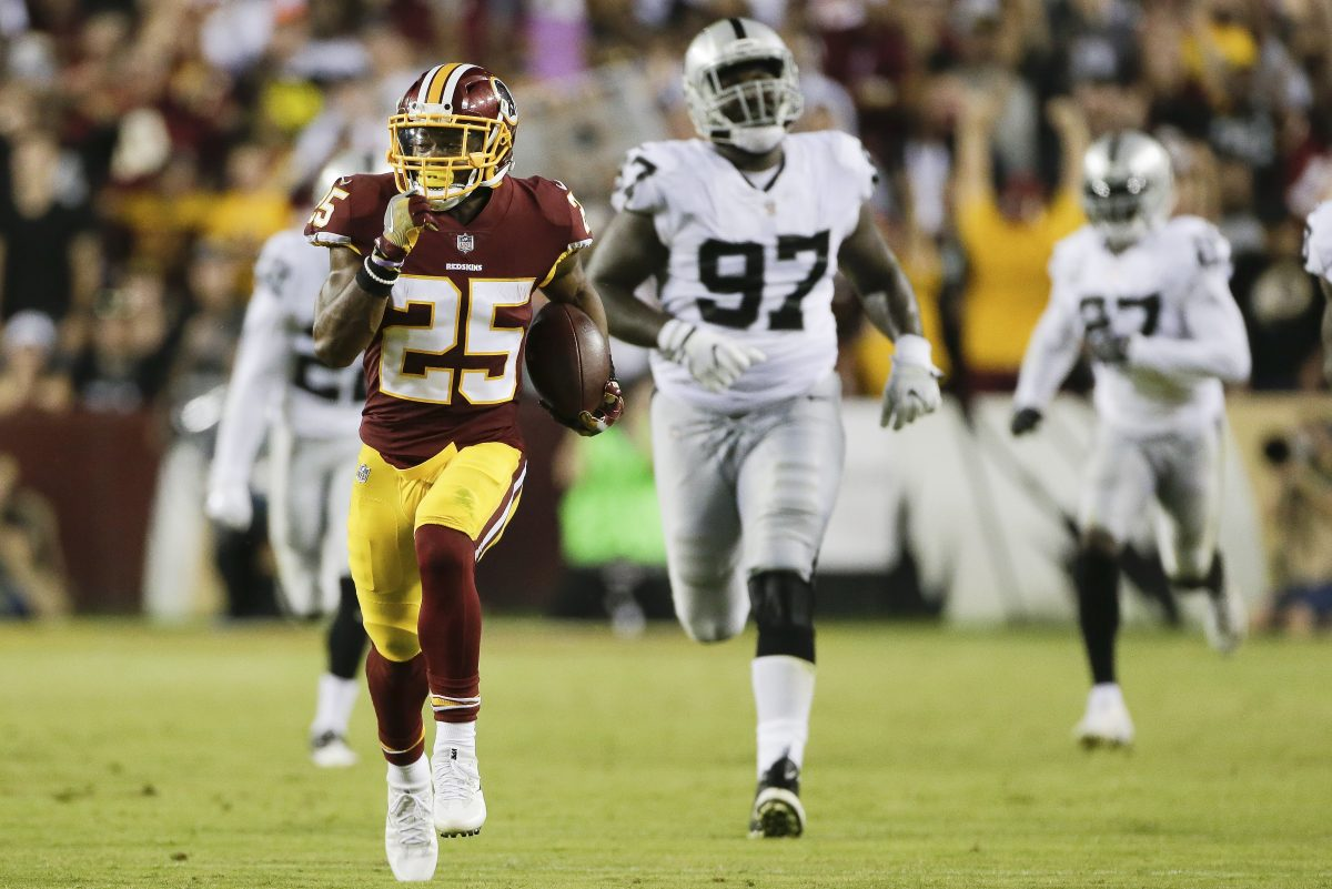 Redskins running back Chris Thompson (left) runs the ball during the second half of the Redskins game against the Raiders on Sept. 24.