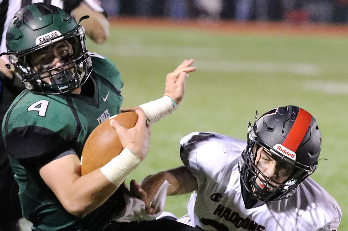 West Deptford's Darren McKeown is almost caught by Haddonfield's Alex Kadar in the second quarter.