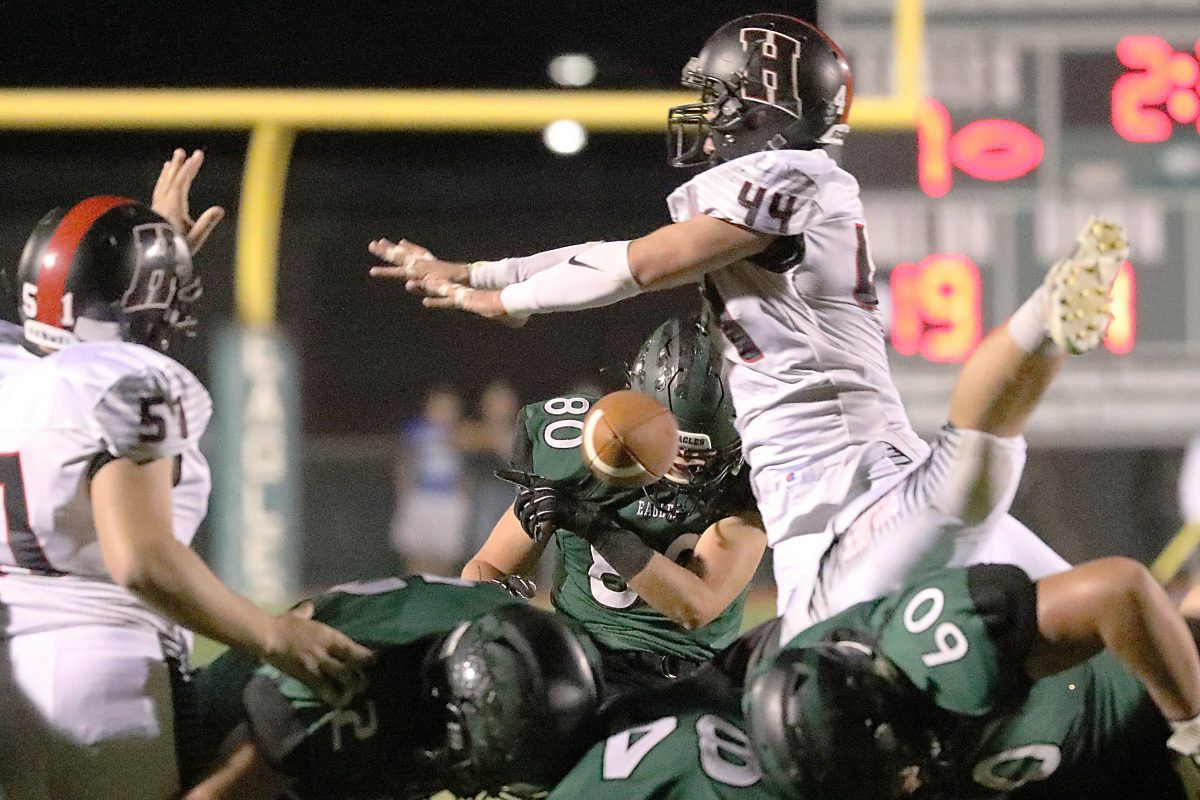 Mike Bilodeau´s field goal kick is blocked by Haddonfield's Will Ciemny during the 2nd quarter.