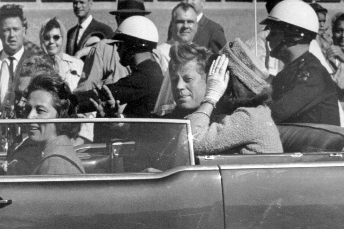 In this Nov. 22, 1963 file photo, President John F. Kennedy waves from his car in a motorcade approximately one minute before he was shot in Dallas. Riding with Kennedy are First Lady Jacqueline Kennedy, right, Nellie Connally, second from left, and her husband, Texas Gov. John Connally, far left. The National Archives has until Oct. 26, 2017, to disclose the remaining files related to Kennedy's assassination, unless President Trump intervenes.