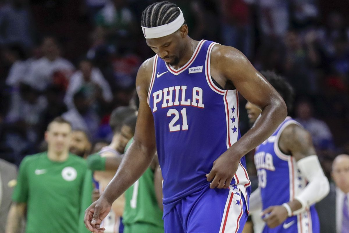 Sixers center Joel Embiid walks off the court after losing to the Boston Celtics 102-92 on Friday at the Wells Fargo Center.