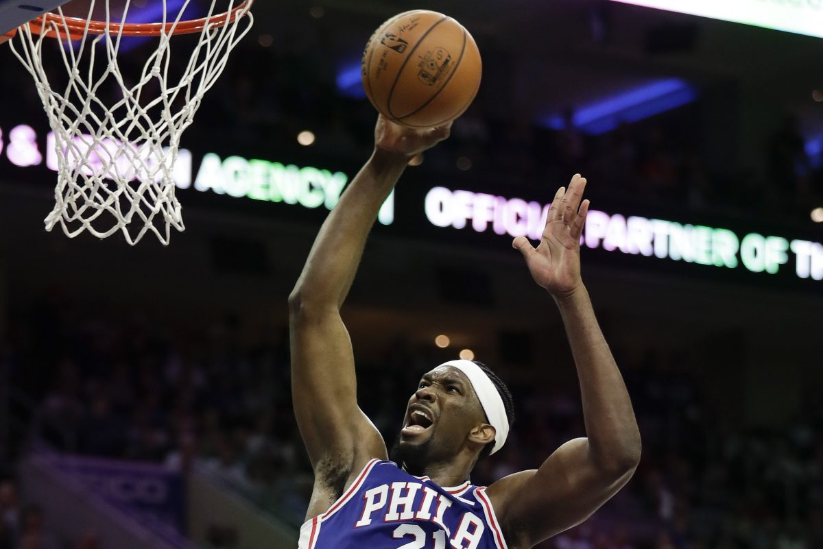 Joel Embiid and the rim — made for each other. YONG KIM / Staff Photographer