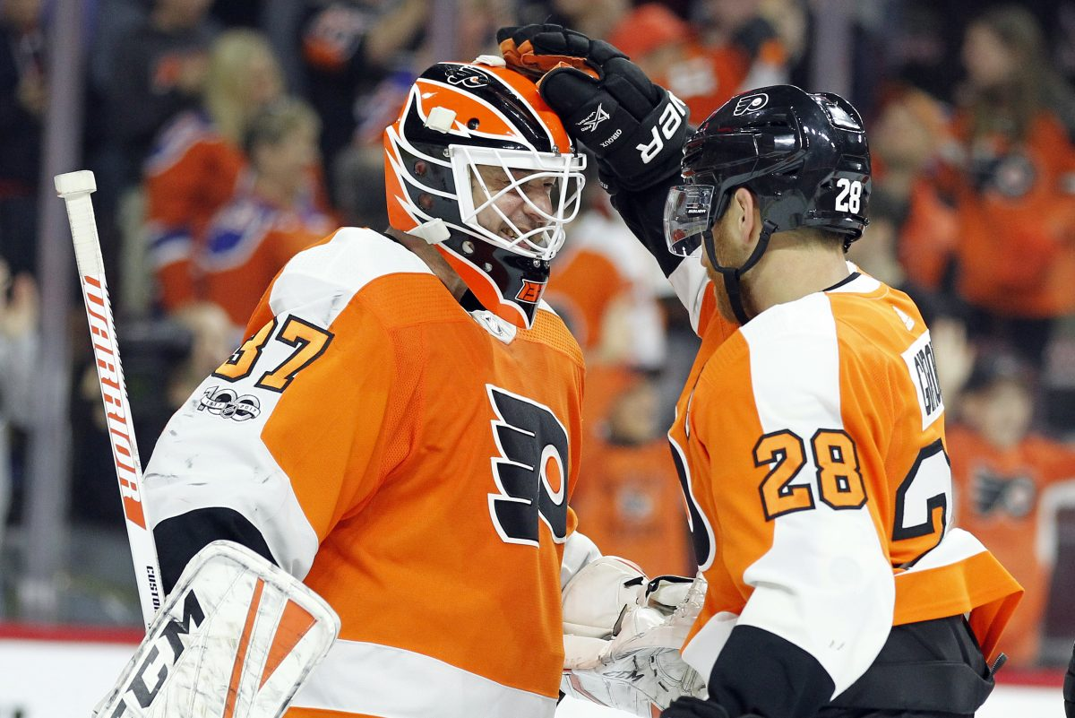 Flyers Brian Elliott (left) and Claude Giroux celebrate the 2-1 win over the Edmonton Oilers on Saturday.