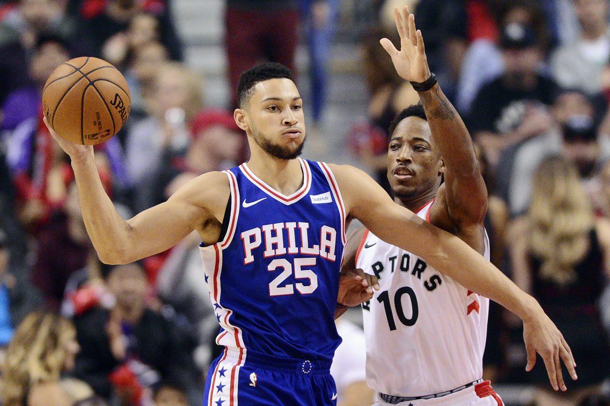 Sixers guard Ben Simmons (left) looks to pass as Toronto Raptors guard DeMar DeRozan.
