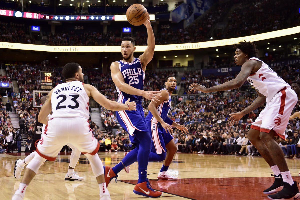 Sixers guard Ben Simmons (25) passes the ball over Raptors guard Fred VanVleet (left).