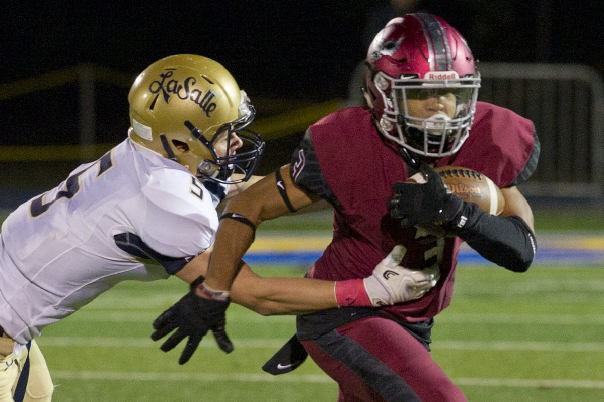 La Salle's Sean Daly tries to take down St. Joseph's Prep's James Cherry during the first half of Friday night's game.