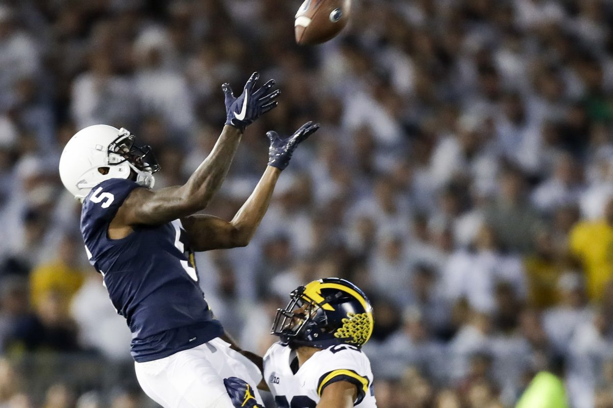 Penn State wide receiver DaeSean Hamilton leaps for a catch behind Michigan defensive back Tyree Kinnel.