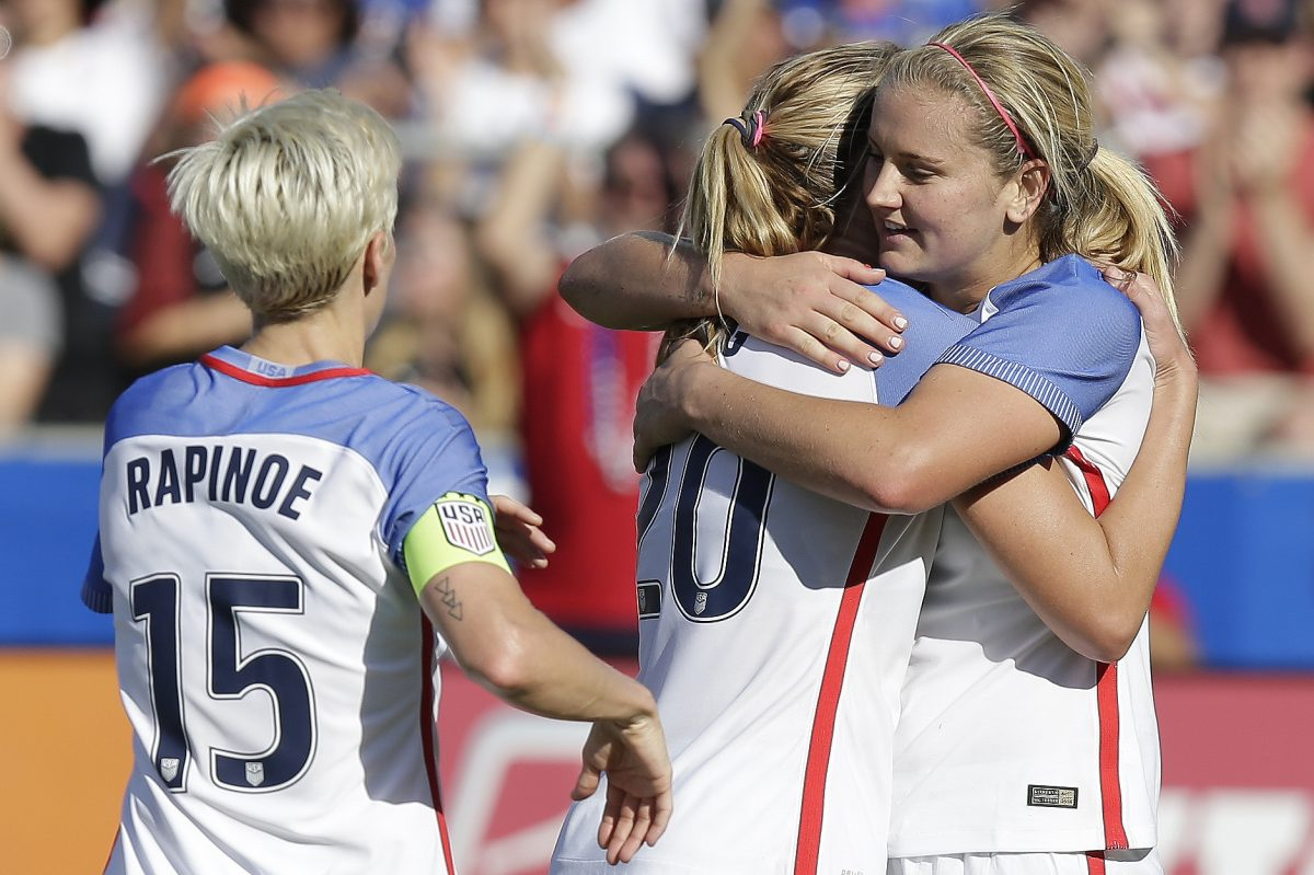 Allie Long (center) celebrates with Lindsey Horan (right) and Megan Rapinoe (left) after scoring a goal in the United States women's national soccer team's 6-0 win over South Korea.