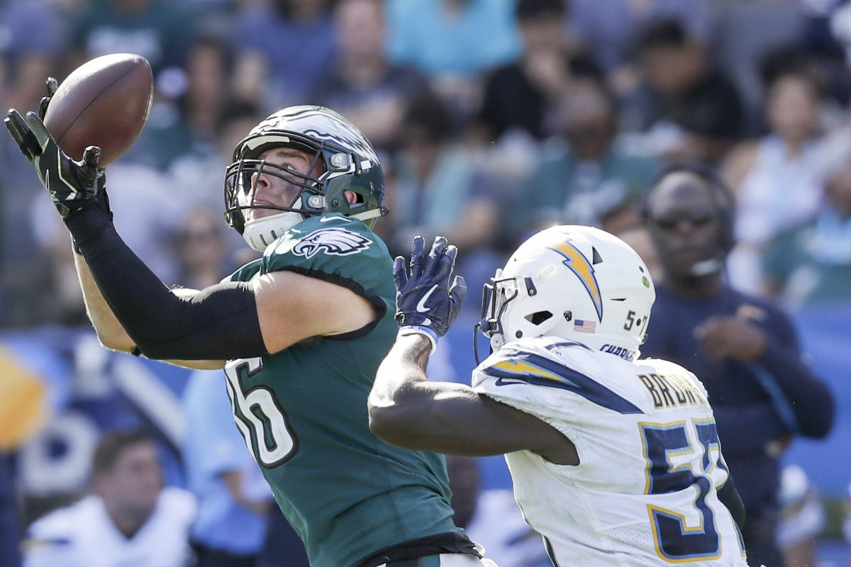 Eagles tight end Zach Ertz catches the football over Los Angeles Chargers inside linebacker Jatavis Brown during the third quarter on Sunday.