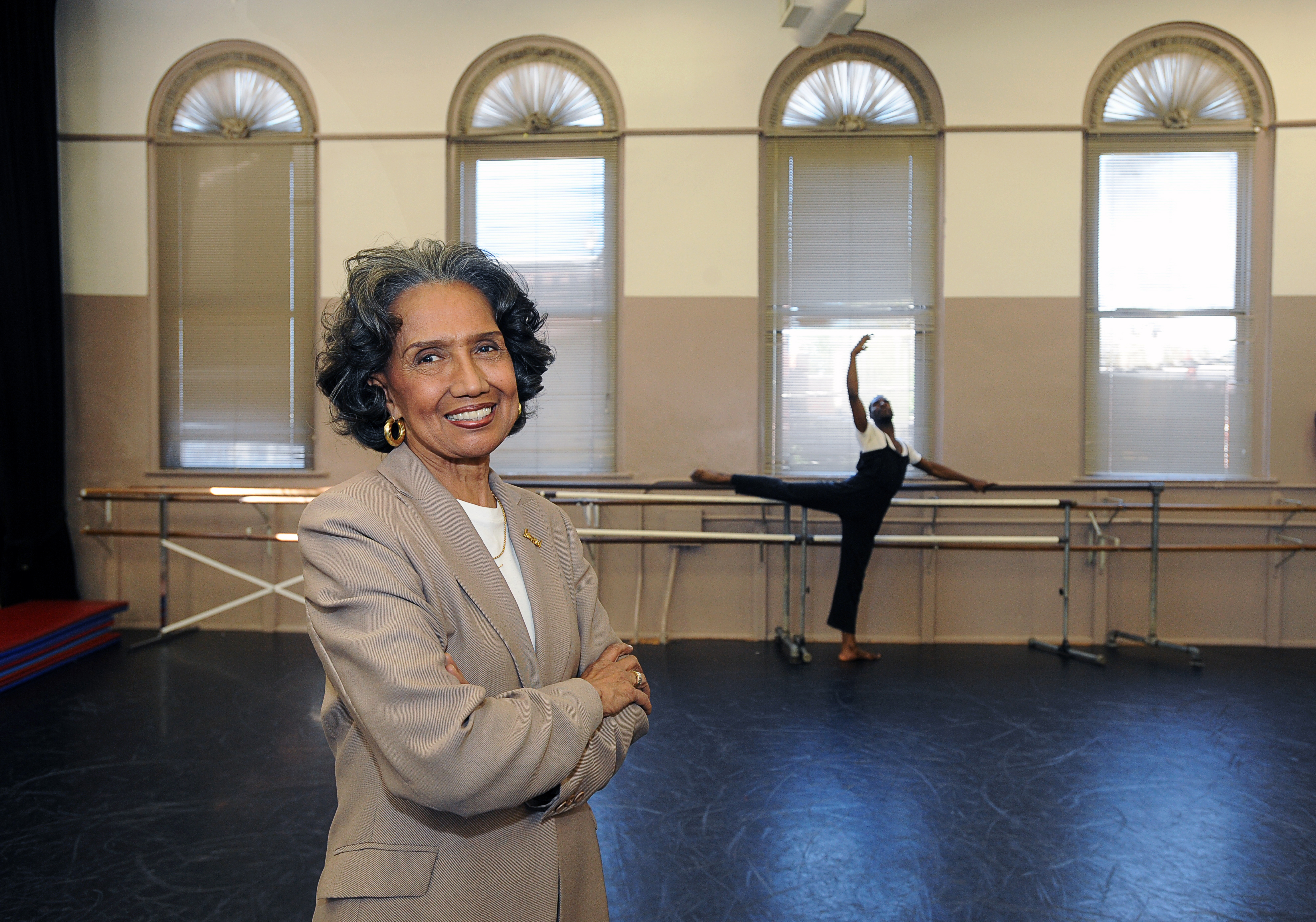 Joan Myers Brown, here in 2010 with dancer Justin Bryant, has received a steady stream of accolades.