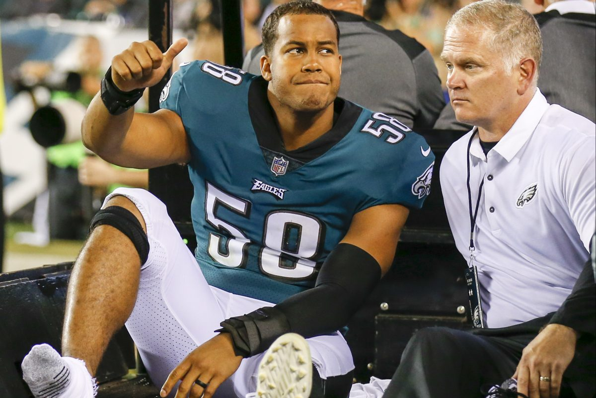 Eagles middle linebacker Jordan Hicks exits the game on a cart after injuring his ankle.