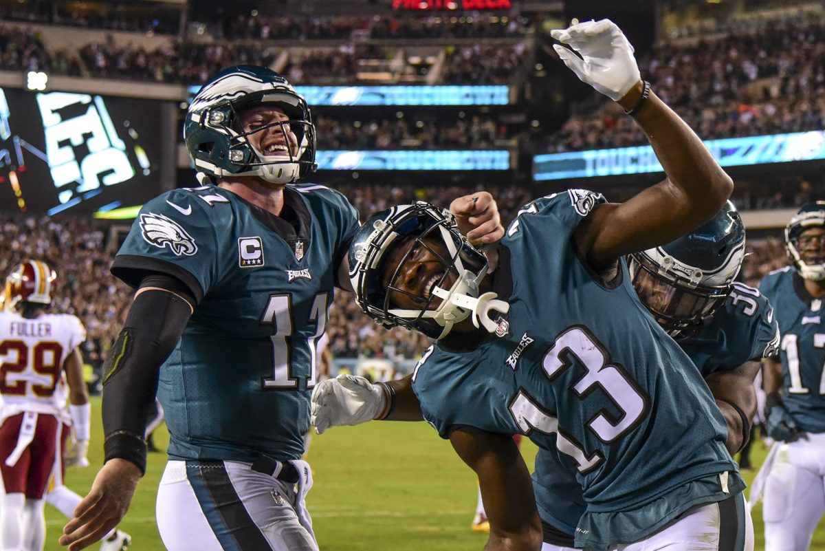 Philadelphia Eagles wide receiver Nelson Agholor and quarterback Carson Wentz celebrte the 10-yard pass and catch touchdown they teamed up on in the 4th quarter of the game against the Washington Redskins at Lincoln Financial Field.
