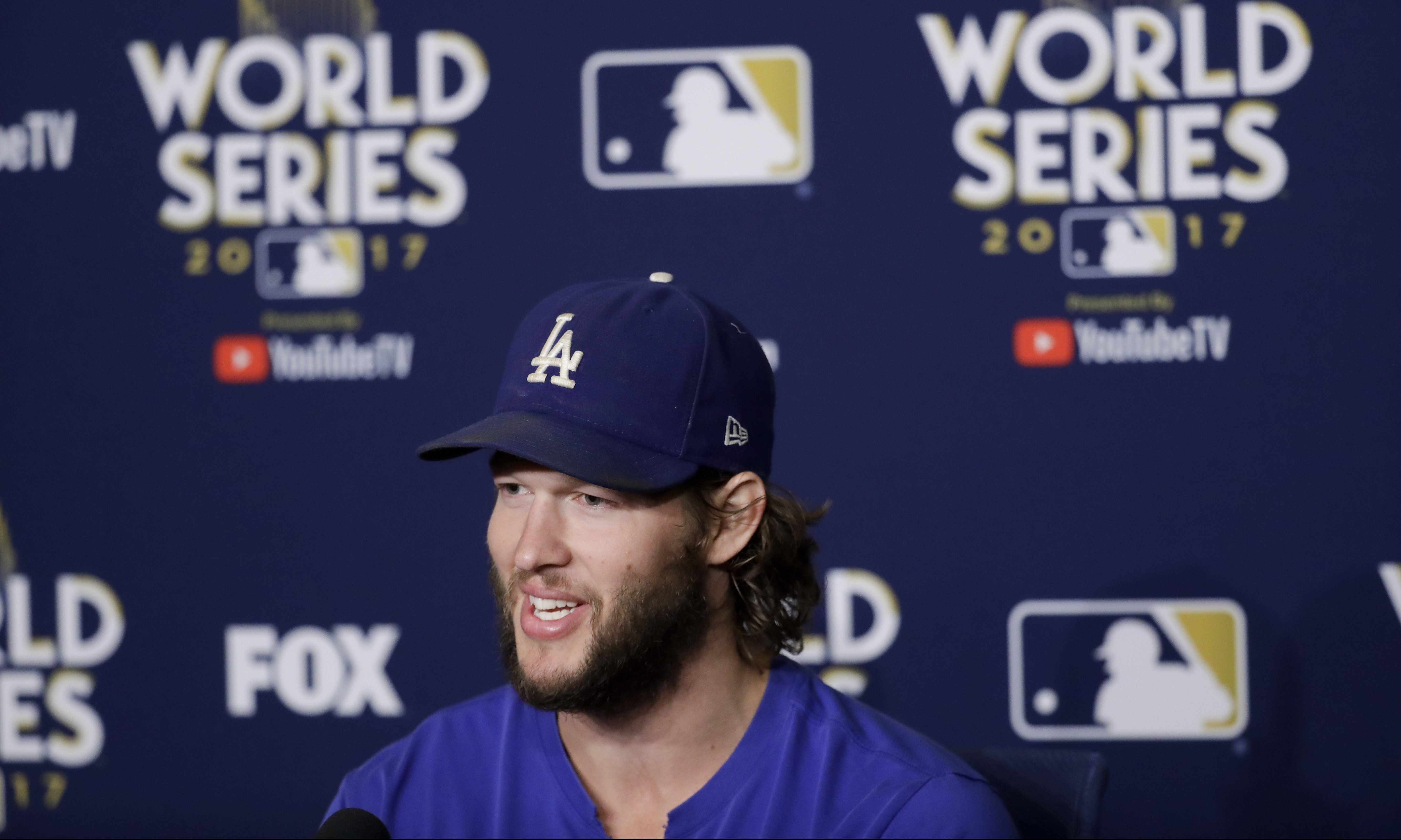 Los Angeles Dodgers starting pitcher Clayton Kershaw talks during a news conference during media day for baseball´s World Series against the Houston Astros, Monday, Oct. 23, 2017, in Los Angeles. (AP Photo/Chris Carlson)