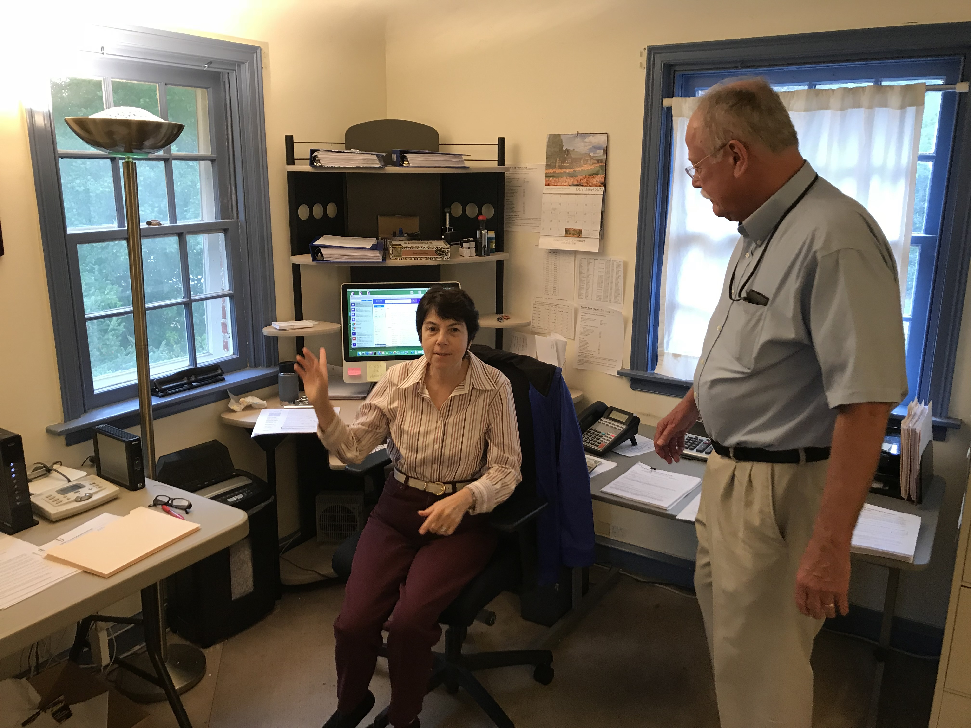 Riders Club Co-Op founder Paxton Wray, right, with his assistant and scheduler Marianne Fluehr at headquarters in Erdenheim (Credit: Erin Arvedlund)