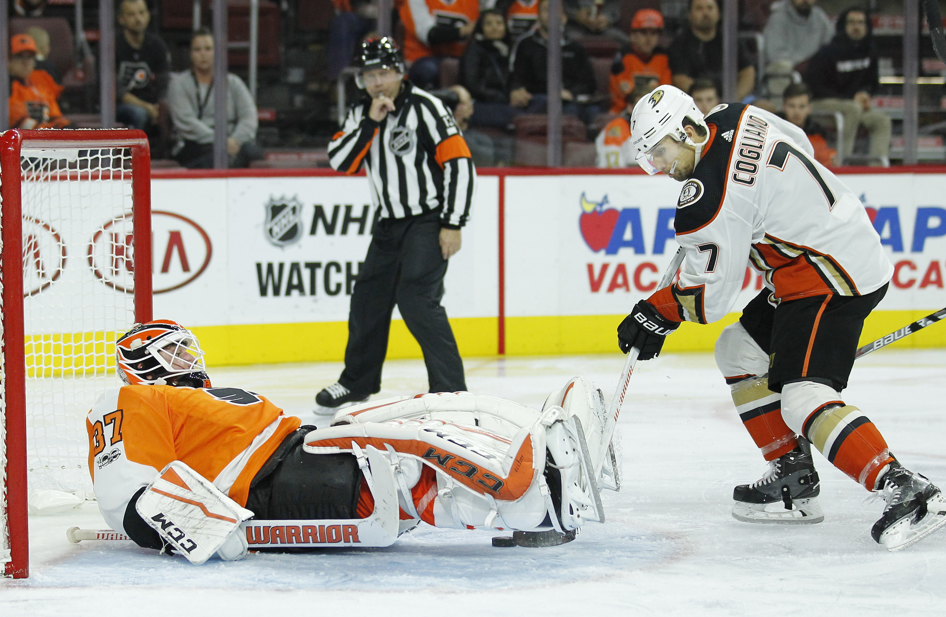 Anaheim´s Andrew Cogliano, right, pokes at a loose puck under the skates of Flyers goalie Brian Elliott. The Flyers lost 6-2. (AP Photo/Tom Mihalek) .