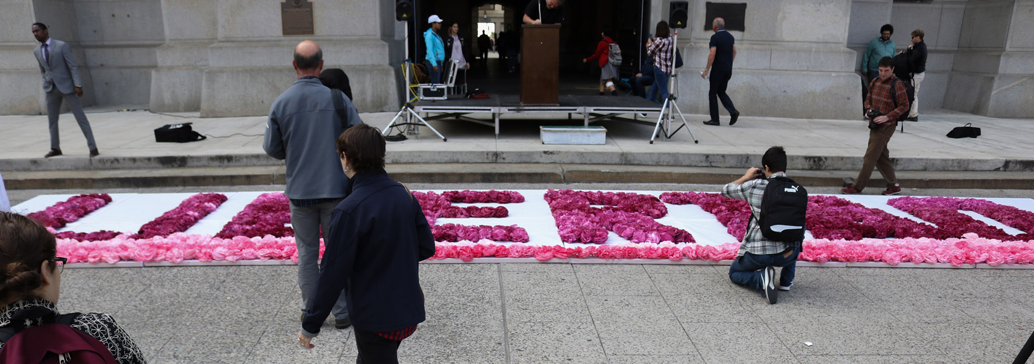 Artist Michelle Angela Ortiz created a monument out of paper flowers at the north entrance to City Hall.