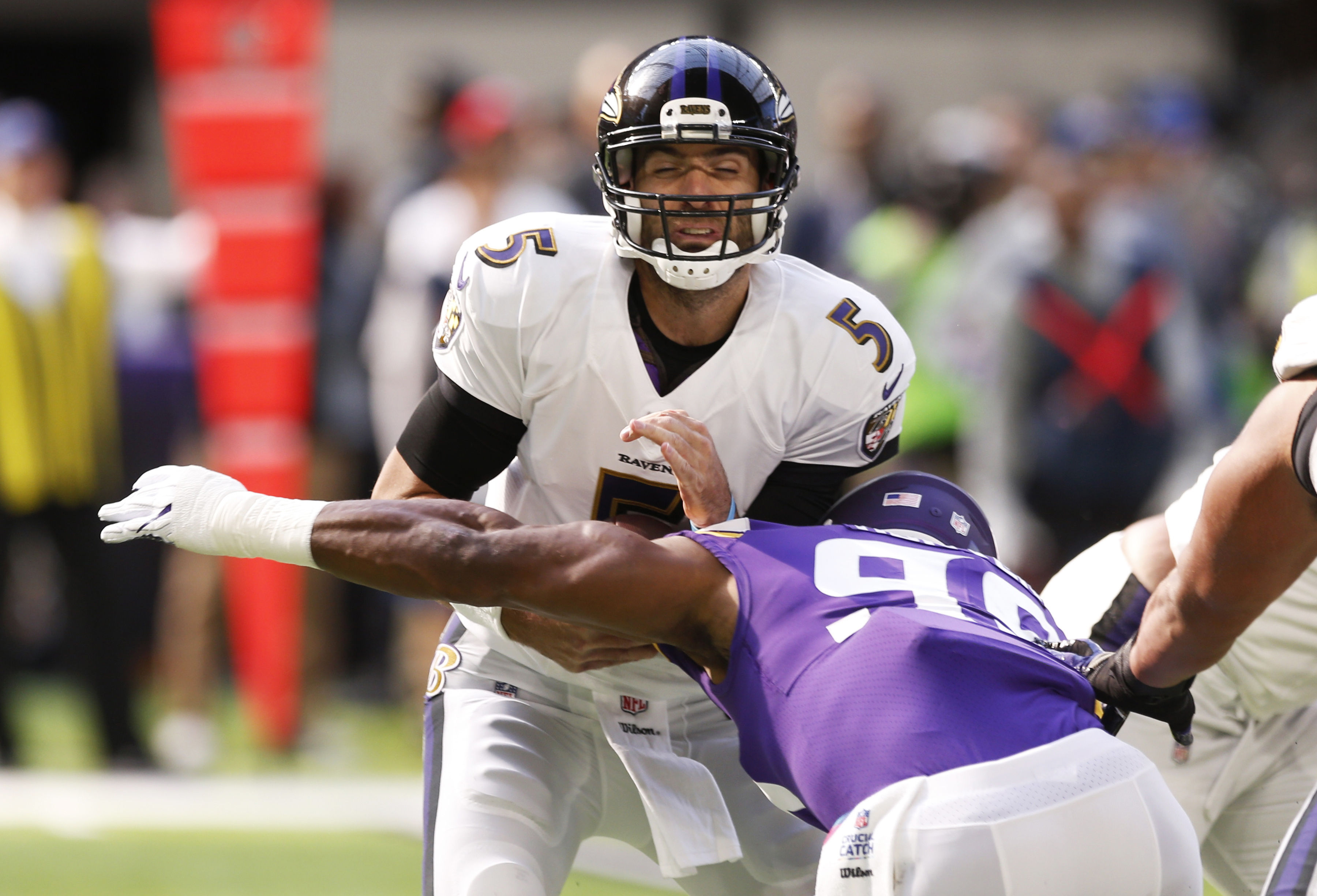 Baltimore Ravens quarterback Joe Flacco (5) is sacked by Minnesota Vikings defensive end Danielle Hunter during the first half of an NFL football game, Sunday, Oct. 22, 2017, in Minneapolis. (AP Photo/Jim Mone)