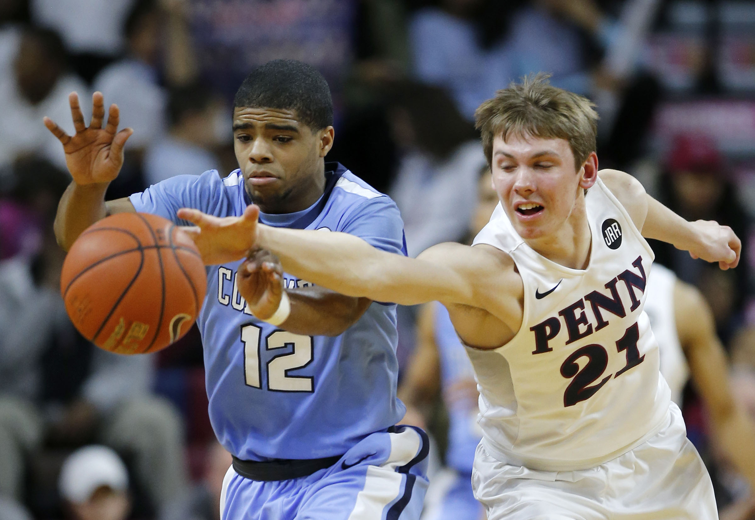 Penn guard Ryan Betley reaches for a loose ball with Columbia guard Mike Smith during a February game.