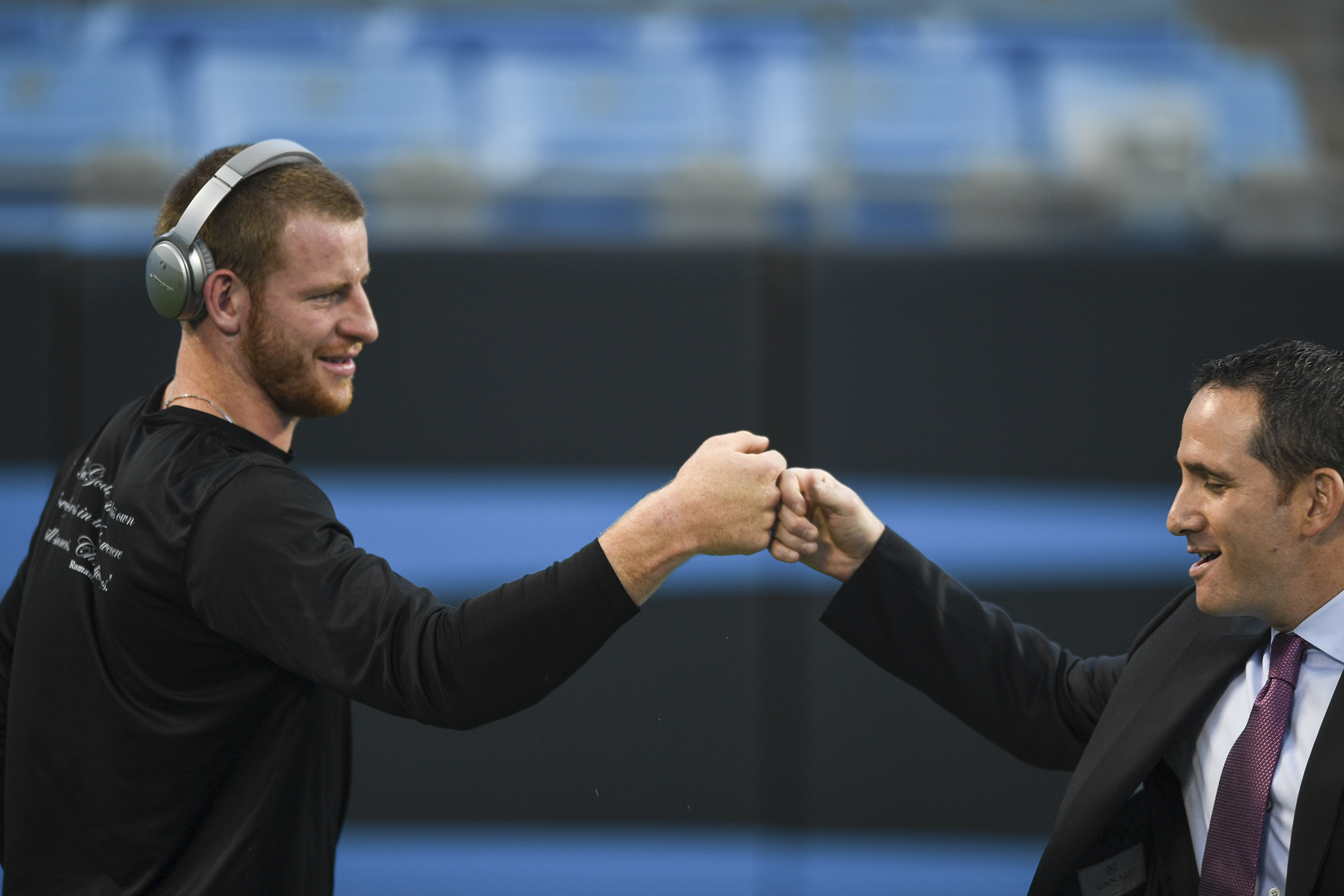 Eagles quarterback Carson Wentz fist bumps with Eagles executive vice president of football operations Howie Roseman prior to the game against the Carolina Panthers October 12, 2017 at Bank of America Stadium. CLEM MURRAY / Staff Photographer