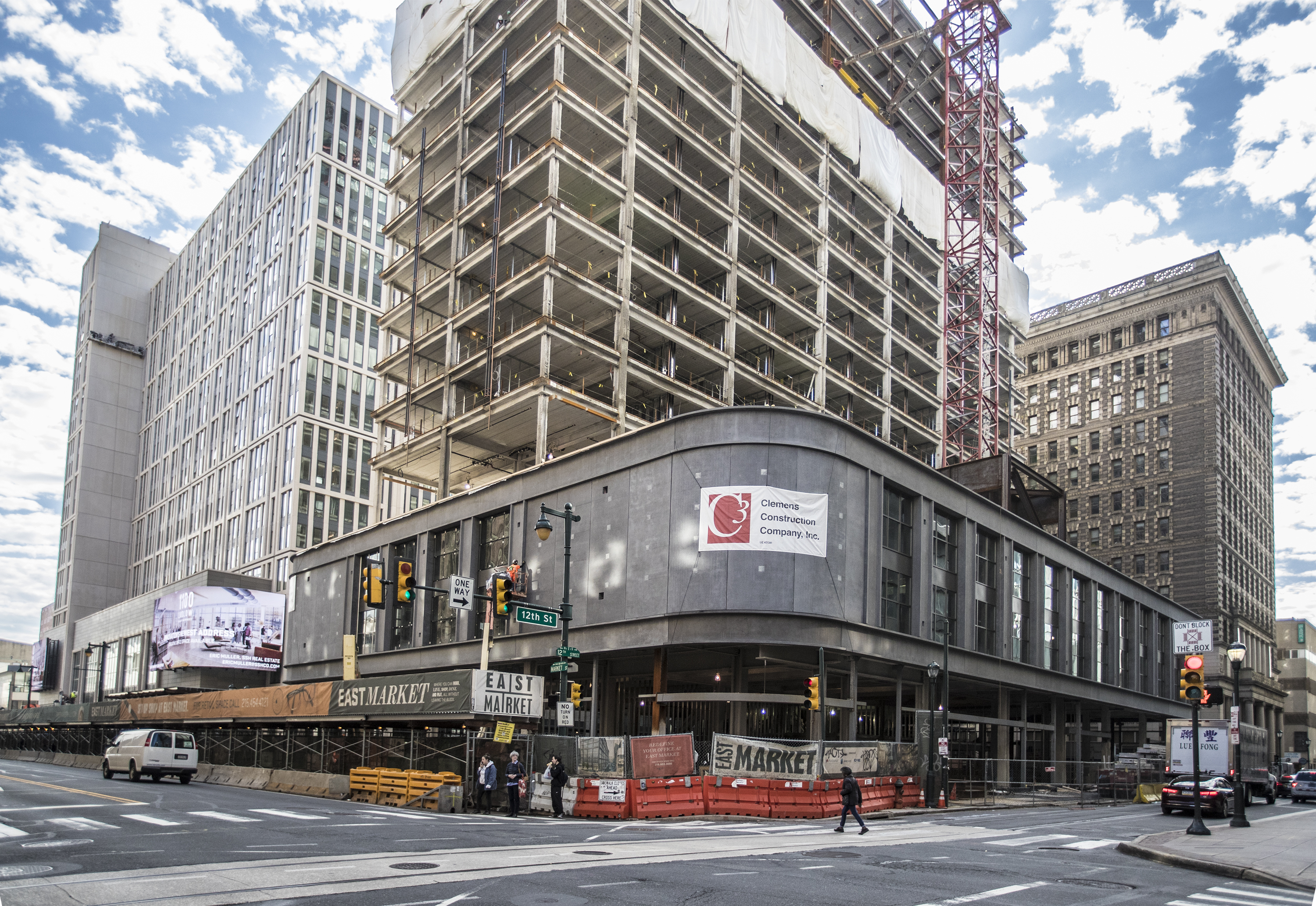 The corner of 12th and Market looking east at the curved facade at the East Market construction site where a T.J. Maxx joins the retail roster in early 2018.