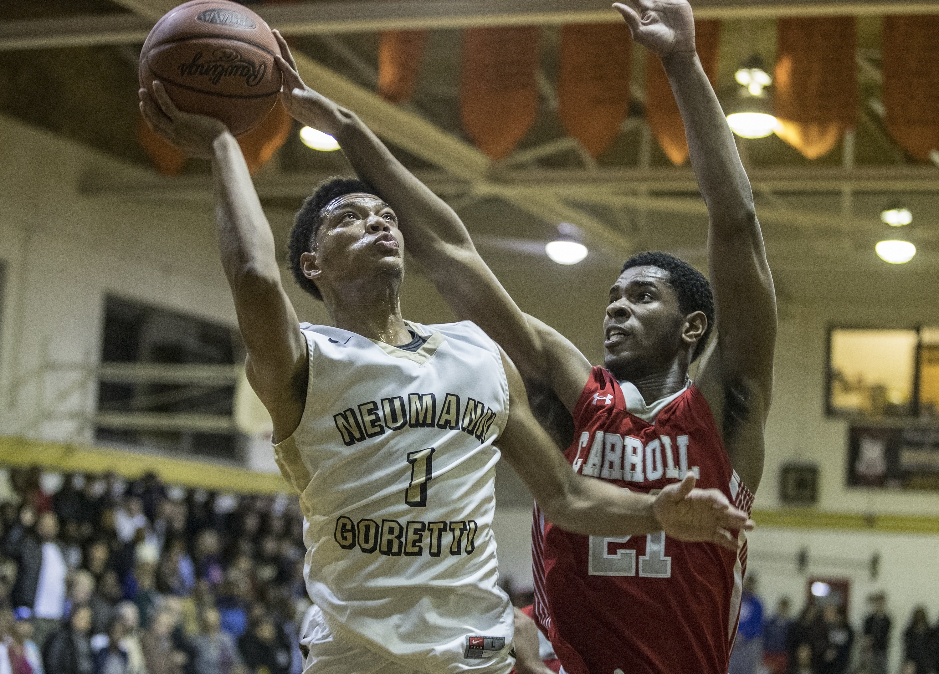 Neumann-Goretti's Quade Green, left, #1, fends off Archbishop Carroll's #21, Jesse McPherson, right, as he takes the ball to the basket during Tuesday night's game. Neumann-Goretti seniors Quade Green and Dhamir Cosby-Roundtree are the top pair of high school players. Green will be at Kentucky next year, Cosby-Roundtree at Villanova. We show how they live the game of basketball. 01/03/2017 MICHAEL BRYANT / Staff Photographer