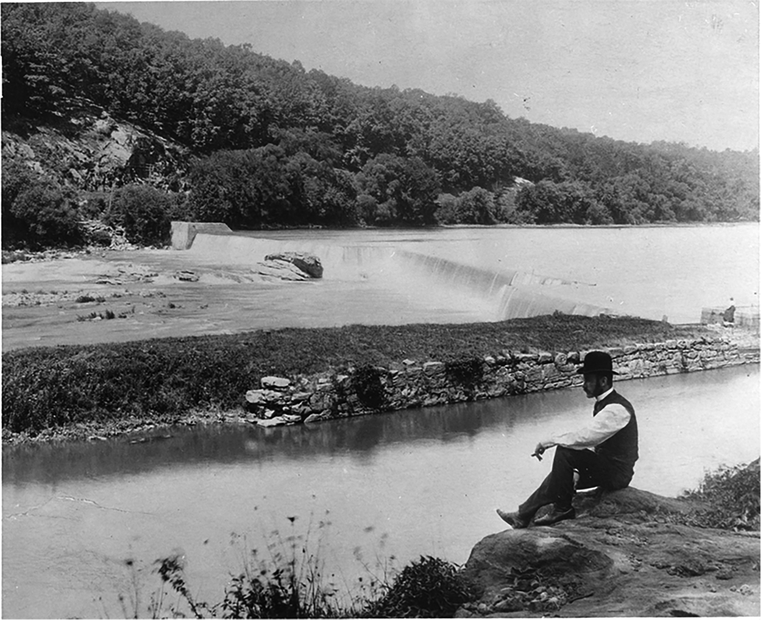 "An 1897 photo of a man at Flat Rock Dam on the Schuylkill, Courtesy of Philadelphia City Archives from the book ""Along the Schuylkill River"" by Laura Catalano and Kurt D. Zwikl."
